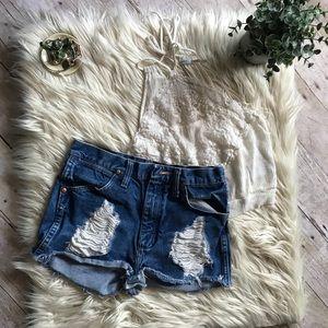 UO Distressed wrangler shorts